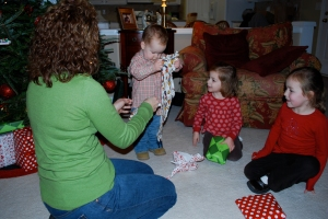 Opening their Chrismas Pajamas---we do this every year