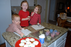 "Baking ""Happy Birthday Jesus"" cupcakes---another Eve tradition"