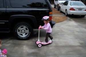 Molly on her scooter from Sweetie and PawPaw (among other gifts)
