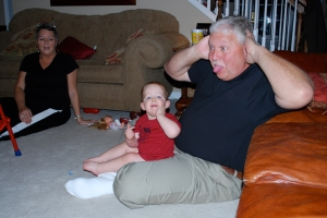 PawPaw & Sweetie came to visit the day after Christmas---not sure which is funnier, that PawPaw is making that face or that he is sitting on the floor