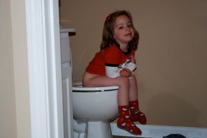 Learning to poop on the potty