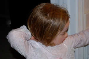 She loaded her hair down with hair serum.  It is still in there today after washing her hair.