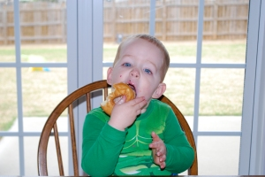 Mack with the doughnut Mrs. Mary left with them when she picked up Ruby for the zoo trip.