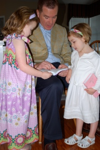 Daddy reading to the girls from their new Bibles