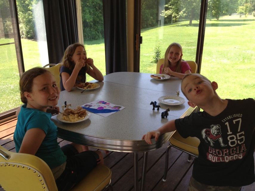 Kids with Katherine on her back porch, just having lunch and playing